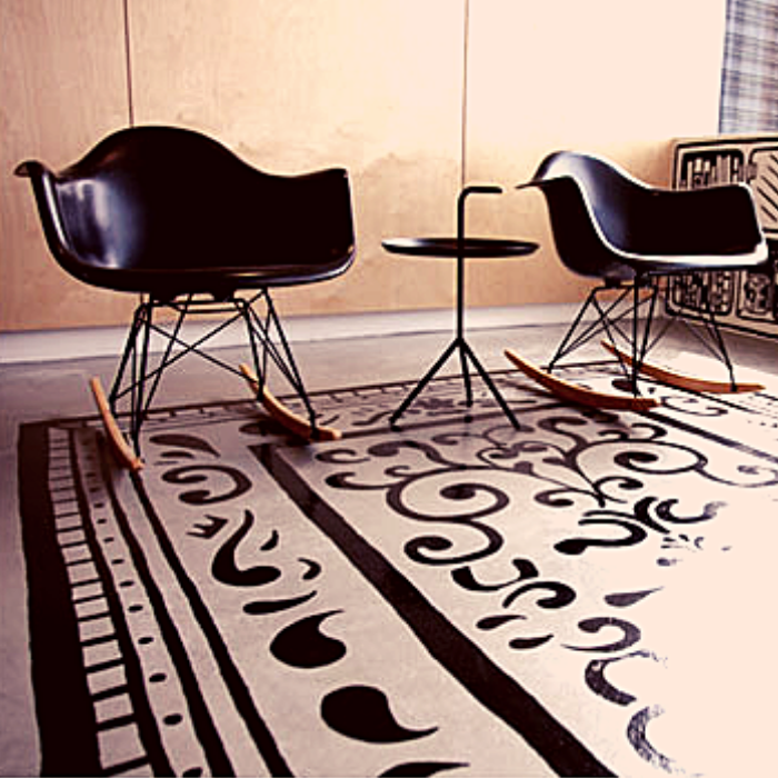 black and whited painted concrete rug