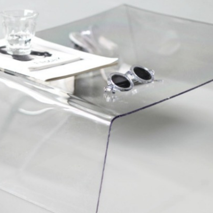 DIY clear side table with clear drinking glass and sunglasses