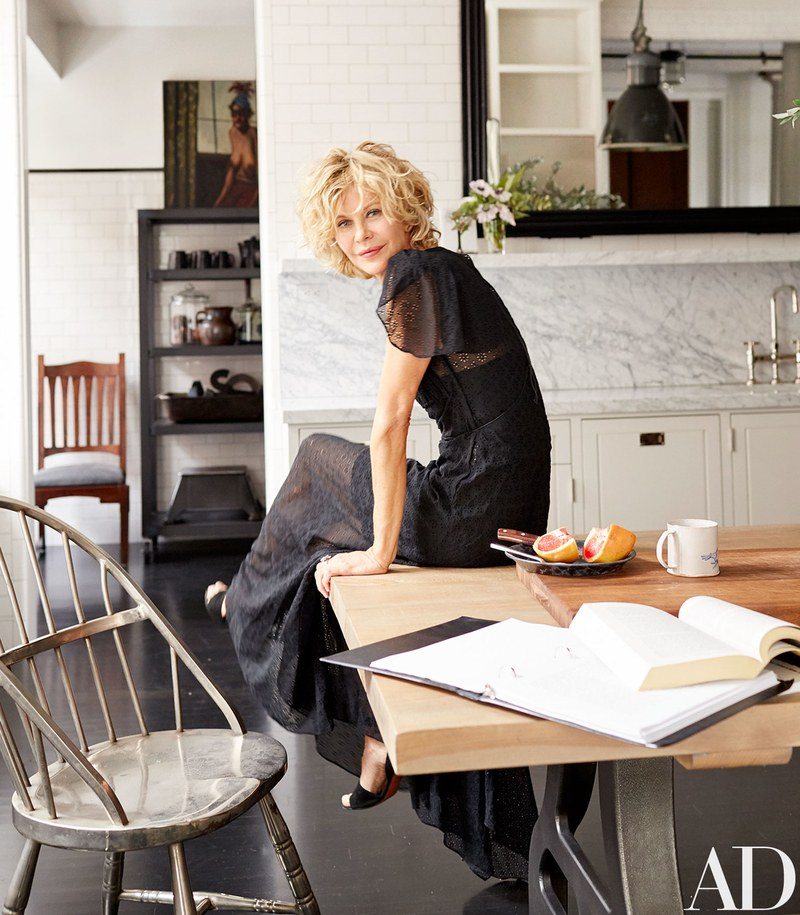 Meg Ryan's sitting on her kitchen table in her NYC Loft