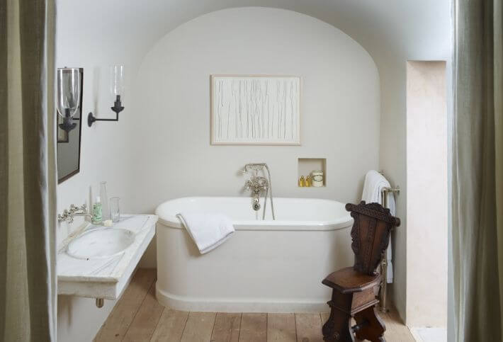 rose uniacke bathroom with vintage chair