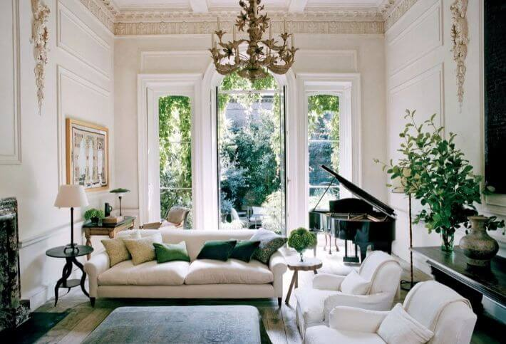 rose uniacke sofa with vintage chandelier