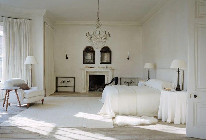 master bedroom with antique chandelier