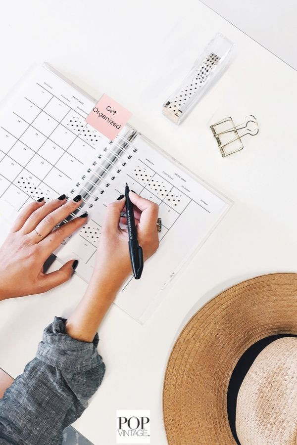 woman writing in calendar with black pen start organizing home