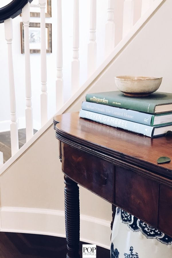 antique entry hall table and vintage bowl