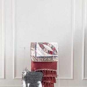 A clear vintage Lucite blanket rack